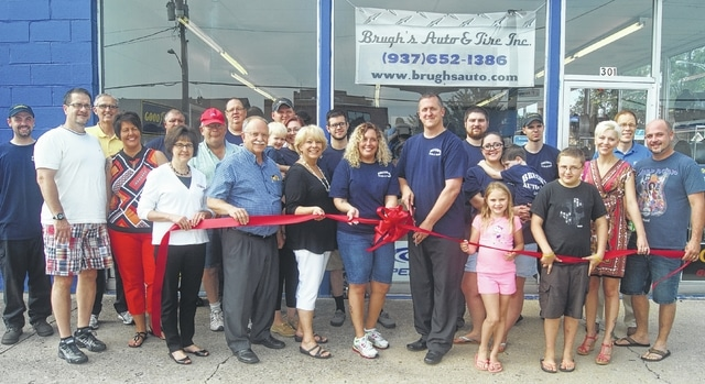 The Champaign County Chamber of Commerce celebrated the grand opening of Brugh's Auto & Tire, Inc. with a ribbon cutting ceremony on Saturday, July 18. From left are Nick Cochran, Michael Morris, Chuck Sweeting, Pamela Payne, Donald Purk, Ellen Pond, Matt Vanscoy, Rick Deis, Bill Minken, Ryan Berry, Andrea Brugh holding Luke Carey, Sandi Arnold, Kyle Furrow, Cortney Brugh, Ryan Brugh, Matt Carey, Ashley Carey holding Brian Carey, Cassady Hilderbrand, Morgan Pond, Ethan Hilderbrand, Jessica Hilderbrand, Dave Ormsbee, and Chad Hilderbrand.
