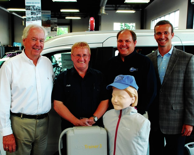 The Mechanicsburg Fire Department received training equipment including a manikin July 24, courtesy of White's Ford. From left are White's Auto Group President Jeff White, Mechanicsburg Assistant Fire Chief/EMS Chief Steve Castle, White's Ford Sales Manager Ben Charles and Zach Doran, Director of Dealer Services for the Ohio Automobile Dealers Association.