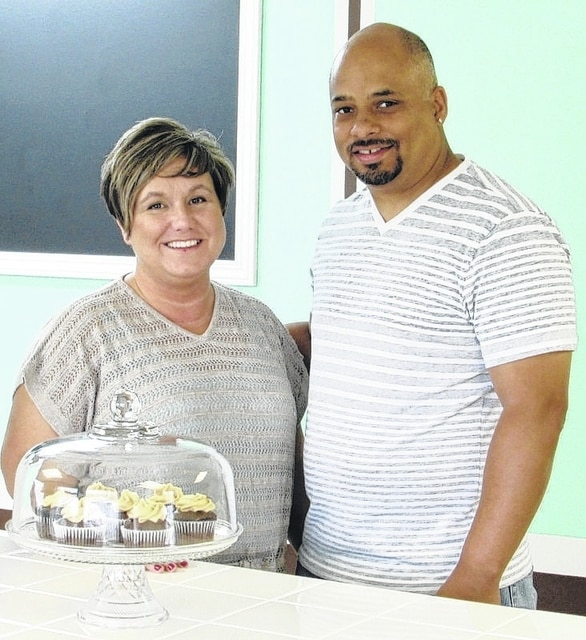 Celestial Cakes and Creations owners Celeste and Anthony Artis display some of their cupcakes. The bakery, in the location of the former Bobby D's Cakes and More on South U.S. Route 68, will open July 21.