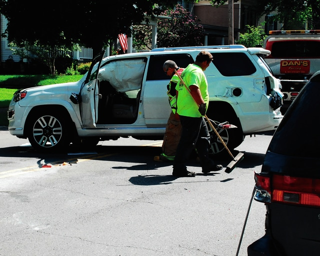 Crews clean up part of Scioto Street following a rollover crash Thursday. The driver of the vehicle, Lee A. Hyland, sustained non-incapacitating injuries.