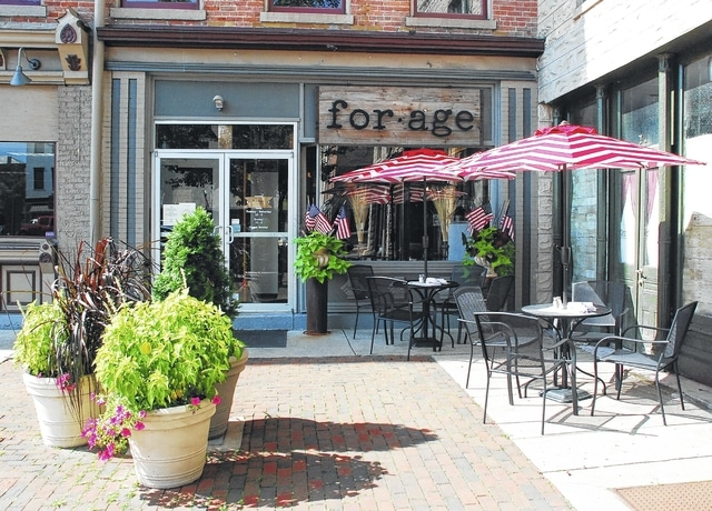 "Forage, a deli and market cafe located at 23 Monument Square, opened its doors in downtown Urbana last month. Owner Kurt Heintz said although the business' name is one word, it appears as ""for•age"" on all his signs because that's how forage appears in the dictionary."