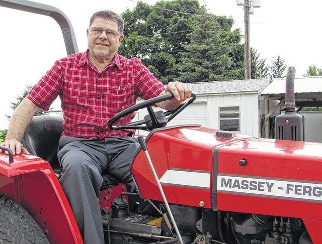 "Cornelius ""Corny"" Friesen, a former Massey-Harris Ferguson tractor dealer, has been a longtime fan of Massey-Harris Ferguson tractors. It is the featured make at the 66th annual Steam Threshers Association. He is seen here with a model 1020 compact tractor."