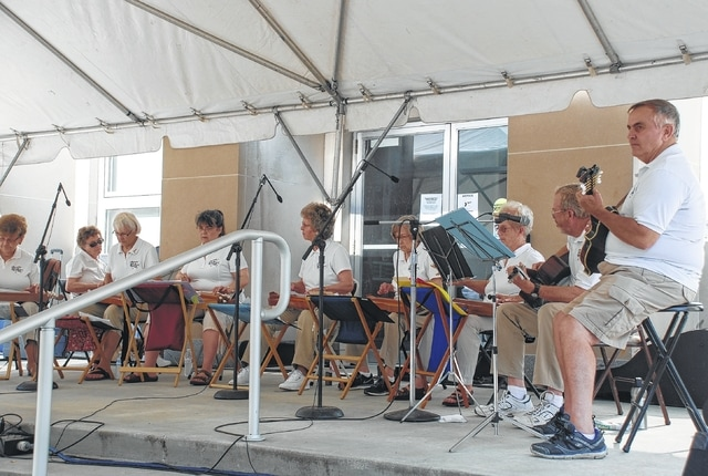 The Champaign County Dulcimers perform on the steps of the courthouse Saturday morning during Art Affair.
