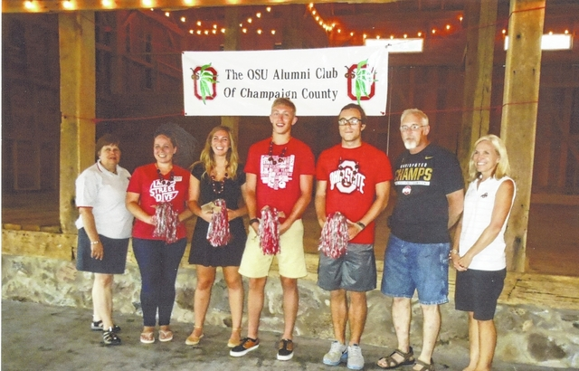 Officers of The Ohio State University Alumni Club of Champaign County with new students are, from left, Chris Harmison, treasurer, Gretchen Klingler, Loren Coffman, David Martin, Kristoffer Hamilton, students, and Richard Van Buskirk, president, and Jill Michael.