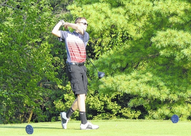 Urbana High School's Greg Coffey tees off the 11th hole, his first of the day, at Urbana Country Club on Monday. Urbana hosted a pre-season tournament for several area schools including Riverside and Tecumseh, among others.