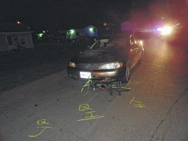 A bicycle is pinned under a vehicle after an accident this week.