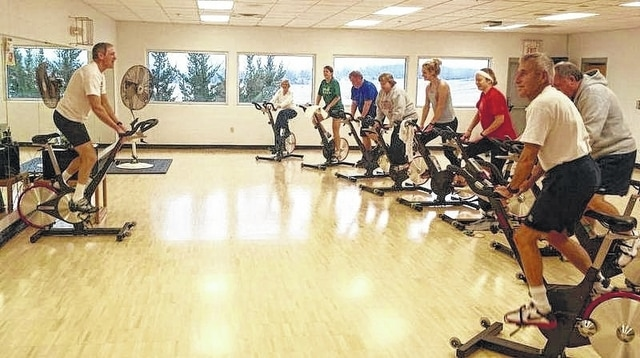 "Champaign Family YMCA Instructor Mark Stadler teaches a group cycling class. Cycling, a ""glow dance"" and pool activities will be part of the ""Staying Fit"" Passport to Wellness event at the YMCA on Sept. 15."