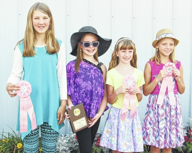 The 2015 Champaign County Fair Junior Division top models are, from left, Honorable Mention Naomi Williams, Top Model Kaitlynn Haynes, Honorable Mention Jessica Rooney, and Honorable Mention Kayla Booze.
