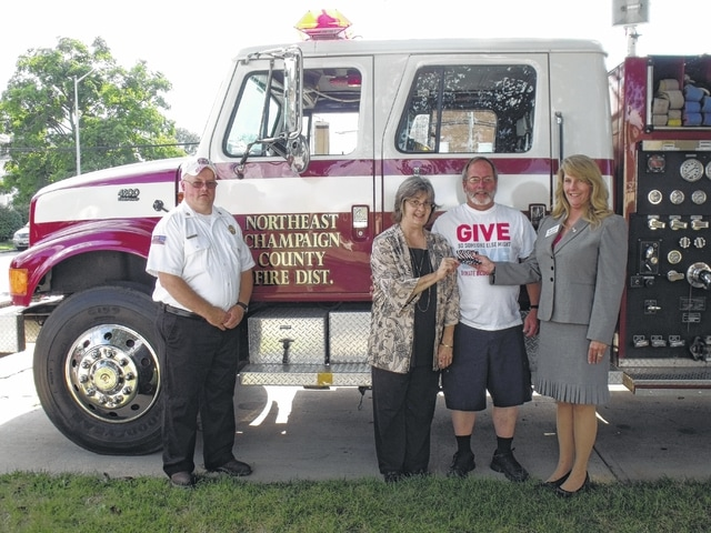 North Lewisburg resident Bryce Brown recently won a $500 gas card after taking part in a blood drive giveaway sponsored throughout central Ohio by the American Red Cross and Marathon Oil. Brown donated blood during a July 9 blood drive hosted by the Northeast Champaign County Fire District. Pictured, left to right, are NECCFD Chief Mike Penhorwood, Pat Bollack-Brown (Brown's wife), Brown and American Red Cross representative Joni Stevens.