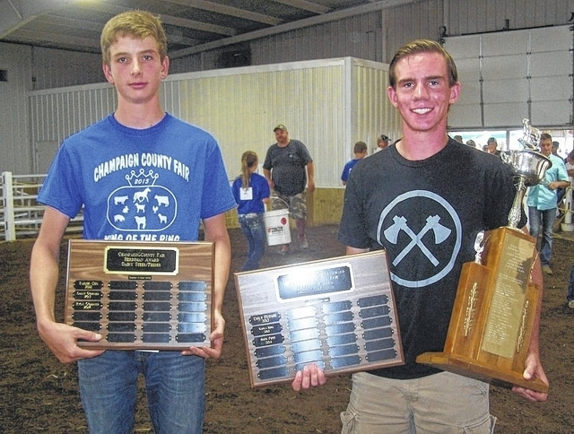 2015 Champaign County Fair winners Matt Goddard, left, and Shem Pond. Goddard won the Dairy Steer/Feeder Herdsman Award. His brothers, Grant and Ryan, are past winners. Pond won the Leslie Broshes Memorial Herdsman Award, for the second year.