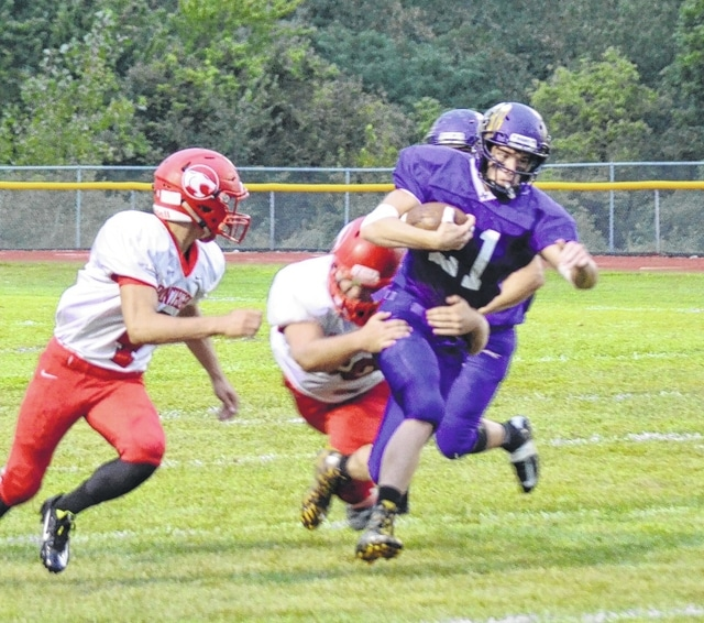 Mechanicsburg's Phil Cook drags a Fairbanks tackler for a moderate gain on Friday night.