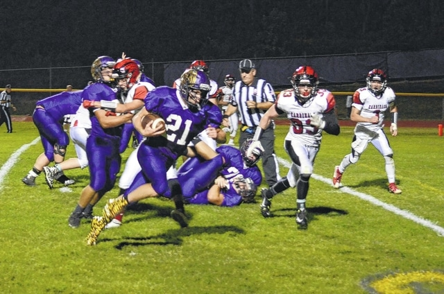 Mechanicsburg's Phil Cook sweeps to the outside and scores against Triad Friday night.