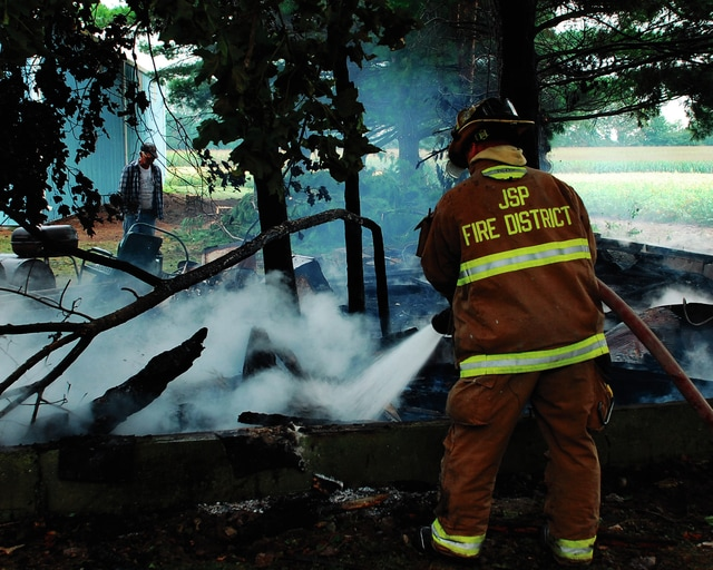 Johnson-St. Paris firefighters work to put out the remains of a fire that demolished a small barn on Stickley Road. No injuries were reported.