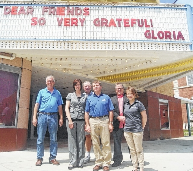 Honda of America Foundation Executive Director Bobbie Trittschuh, second from left, recently visited the Gloria Theatre in Urbana to view renovation progress. Honda has awarded the GrandWorks Foundation a $75,000 grant to support the theater project over three years. Joining her in front of the theater marquee are, from left, Design/Build Committee Chariman and GrandWorks board member Dave Smith; Campaign Planning Committee Chairman and Vice Chairman of the GrandWorks board Don Sanders; GrandWorks board Chairman Steve Hess; Community Fundraising Planning Committee Chairman and GrandWorks board member Jon Umstead; and Administrative Manager of the GrandWorks Foundation Lydia Hess.