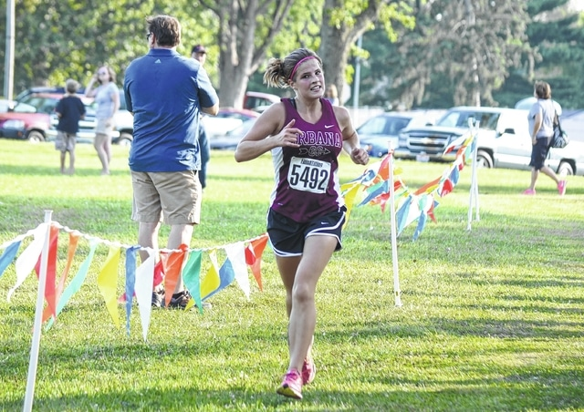 Urbana's Tabitha McCall dashes to a second-place finish at the Urbana End of Summer Run at Melvin Miller Park on Tuesday.