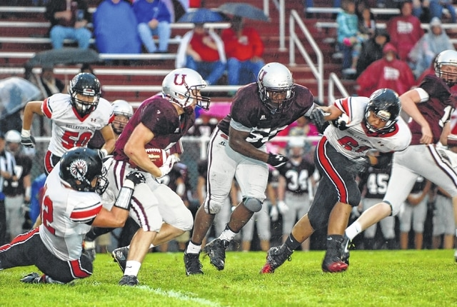 Urbana's Max Niswonger runs the ball against the Bellefontaine defense during the first quarter of Friday night's game.