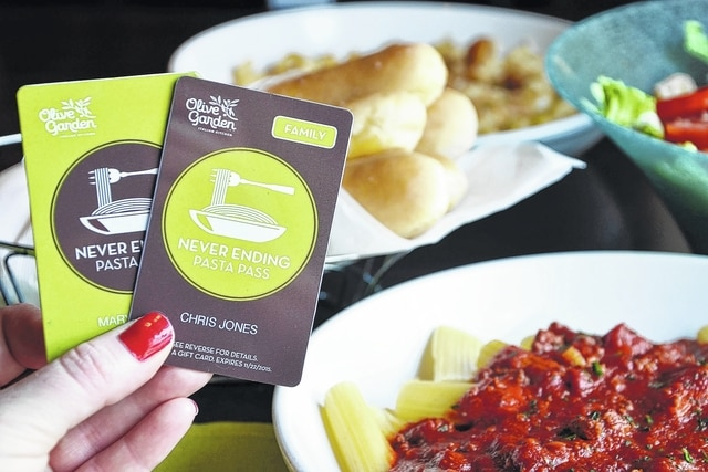 """This undated image provided by Olive Garden shows the individual and family versions of Olive Garden's """"Never Ending Pasta Pass."""" Olive Garden in Springfield is using the promotion to reward outstanding acts of altruism or help a family in need in the larger community, which includes Champaign County."""