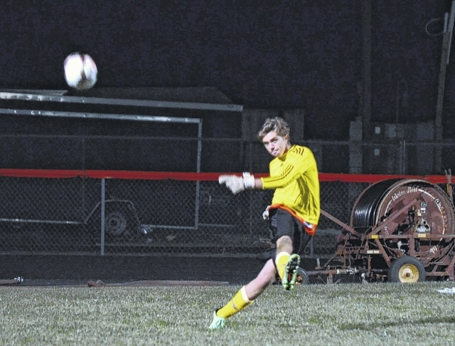 West Liberty-Salem's Elias Kirker-Napierkowski clears the ball with a goal kick Tuesday night against Catholic Central.