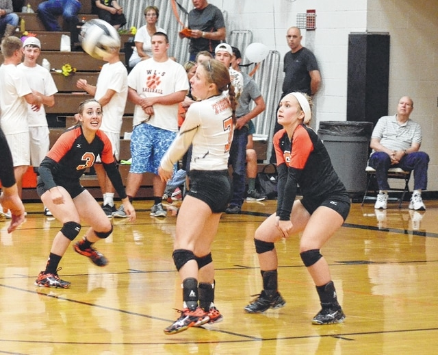 West Liberty-Salem's Olivia Ames receives a serve while her teammates look on Monday versus Mechanicsburg.
