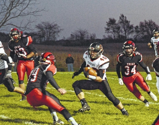West Liberty-Salem's Brandon Wolfe (40) slashes through the middle of the Triad defense Friday.
