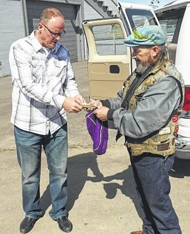 American Thunder Motor Club President Steve Nott, right, presents a donation to River of Life Christian Center Pastor and county Community Christmas Committee member Dan Leiker following the motor club's annual Toy Run on Oct. 4.