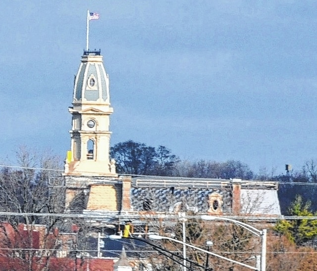 On June 29, 2012, the clock-tower on the Logan County courthouse was severely damaged by 70 mph wind gusts that twisted the tower on its base some 70 feet above the ground. While the clock-tower still stood after the storm, it was dismantled for safety reasons, leaving a hole in the Bellefontaine skyline for over two years. That hole was filled this past week when Midstate Contractors used a 350-foot boom to place the restored clock-tower to its rightful spot in the Logan County skyline. The renovations to both the clock-tower and courthouse are expected to be completed by spring.