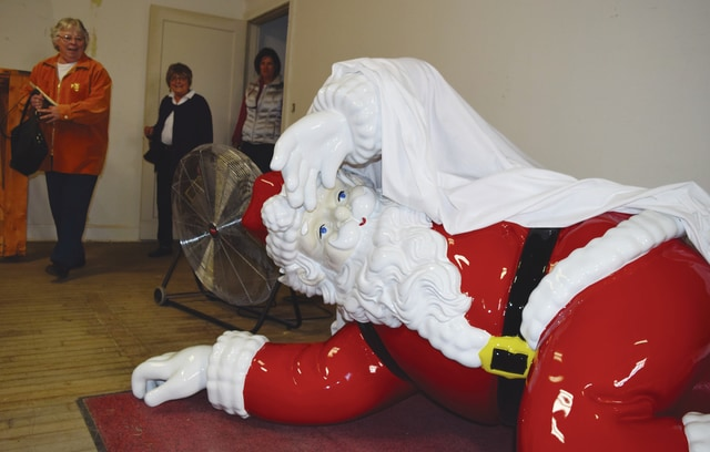 A large Santa statue has been spruced up for display at the Gloria Theatre. Here, he reclines in the Gloria following cosmetic work and cleaning.