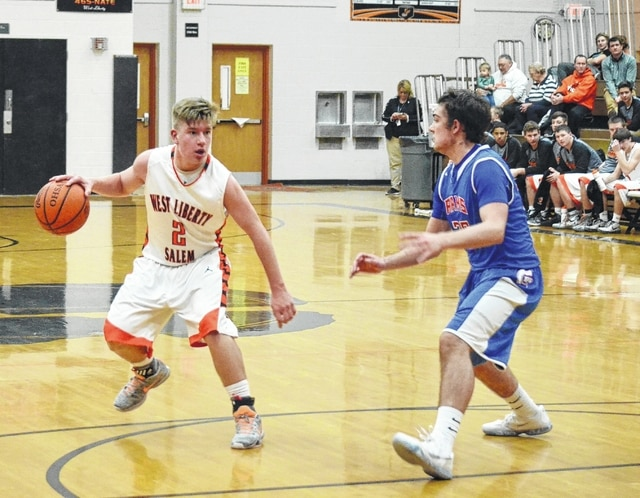 West Liberty-Salem's Dillon Callicoat dribbles away from pressure against Greeneview Tuesday night. Callicoat scored 8 points in the game to help the Tigers to victory.