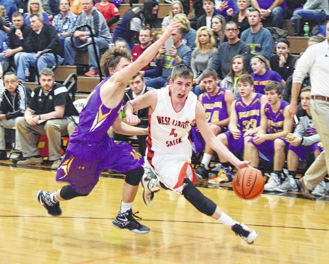 West Liberty-Salem's Tyler Louden goes around his man on the baseline Friday night against Mechanicsburg at WL-S.