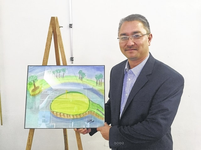 Jerome Armstrong is a financial advisor with Edward Jones. He enjoys golfing and is the coach of the Urbana High School boys' team. His artwork features the 17th green at TPC Sawgrass.