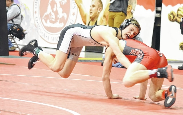 Graham's Jeffrey Thomas gets off the ground while he circles his man in the Division II 113-pound weight class Thursday at the state wrestling tournament.