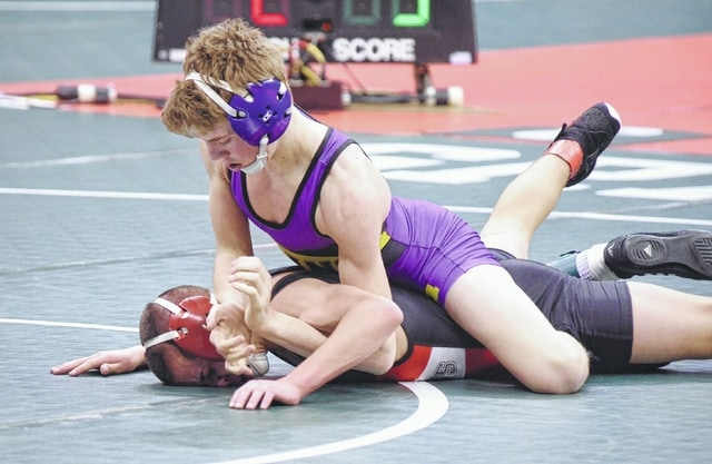 Mechanicsburg's Tyler Wetzel claims his victory over Marion Pleasant's Carter Wolf at 113 pounds in Division III on Thursday at the state wrestling tournament in Columbus.