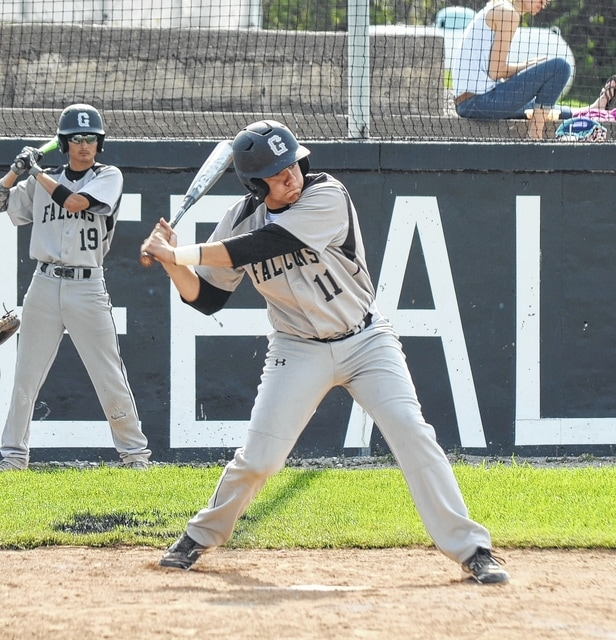 Graham's Mark Ward hacks at a pitch in the strike zone Monday versus Benjamin Logan.