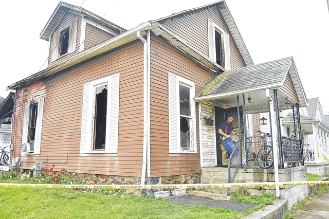 Sidney firefighters were still on the scene of a house fire at 8:30 a.m. Thursday, April 21. The fire at 519 W. North St. claimed the lives of a woman and a child. Two adults and a firefighter were treated for smoke inhalation.