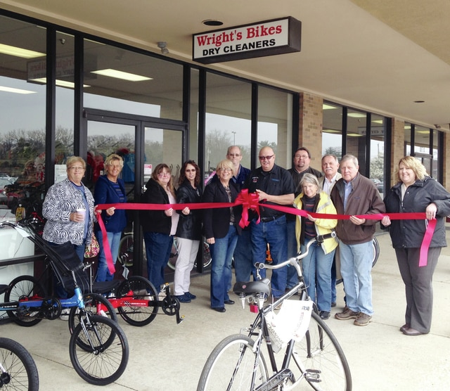 The Champaign County Chamber and friends of the community recently celebrated the grand reopening of Wright's Cleaners & Wright's Bikes, LLC at their new location at 1637 E. US Hwy 36, Suite 9 in Urbana. Guests arrived at 11:45 a.m. for the noon ribbon cutting on Friday, April 8. For more information on past or future ribbon cuttings, please call 937-653-5764. Pictured from left are Sunny Krugh, Kathy Brown, Rita Vanhoose, Catherine Loeloff, Sandi Arnold, Mike White, Owner Jeff Wright, Rodney Krugh, Patsy Thackery, Larry Krugh, Pat Thackery and Lora Brown.