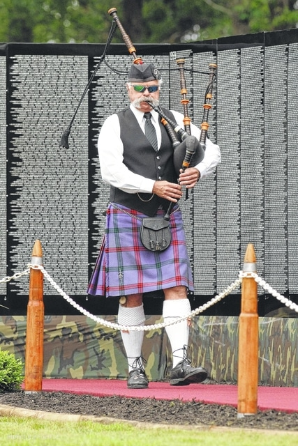 A bagpiper in Camden, Tennessee, performs during a ceremony held at The Moving Wall exhibit.