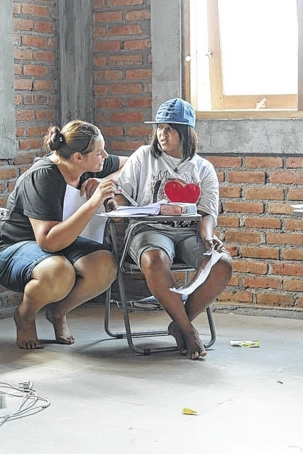 Urbana native Michelle (Hunsberger) Zook teaches English to a 17-year-old trafficking victim in a safe house located in Southeast Asia.