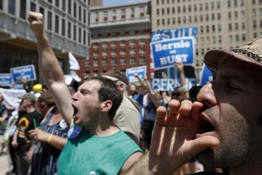 Young supporters of Sen. Bernie Sanders yell during a rally in Philadelphia, Tuesday, July 26, 2016, during the second day of the Democratic National Convention. Millennials will make up a sizable portion of voters in the November election. (AP Photo/Alex Brandon)
