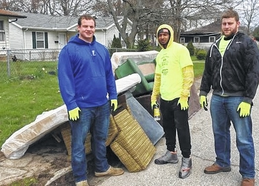 Urbana University students, from left, Doug Hardin, DarSean Watts and Julian Simon work in the Community Clean-up sponsored by the Alicia Titus Memorial Peace Fund.