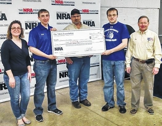 "Urbana University's Shooting Sports Team received a gift from the NRA Foundation. Distributed through the West Central Ohio Friends of the NRA, the funds will be used to purchase competition pistols. According to Ken McCabe, coach of the shooting sports program, ""The tremendous support we have received from the NRA Foundation has helped to transform the shooting sports program here at the university. As a result of this gift, our students use excellent equipment and will be equipped to compete with some of the premier teams in the region."" Team members and others, from left, are Emily Davis, Seth Collier, FNRA Chairman Jerry Blosser, Kenny Sharp, Coach Ken McCabe."