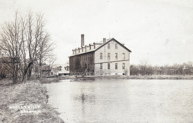 "This ca. 1914 photo post card shows the ""old wollen mill"" in the East Water Street building that now is home to Russell T. Bundy Associates Inc."