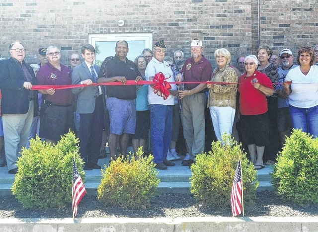 The Champaign County Chamber hosted a celebration for completion of their canteen with the local chapters of the VFW and DAV at their headquarters at BrownRidge Hall, 220 E. Court St. in Urbana. Shown are, front row, Urbana Mayor Bill Bean, Bill Gibson, Joshua Tovey, Liaison Ohio Secretary of State, Buzzy Moore, Orrin Grosjeau, VFW Commander Craig Bennett, Chamber Executive Director Sandi Arnold, Marilyn Henderson, Rocky Mills, back row, Connie Huffman, Woody Bennett, Jerry Henderson, Pat Grosjeau, Bob Max, Karen Henderson, Merie Walter, Jenny White, Ron Woodruff, Marcia Bailey, Champaign Economic Development, Bob Jenkins and Dennis Abplanalp.