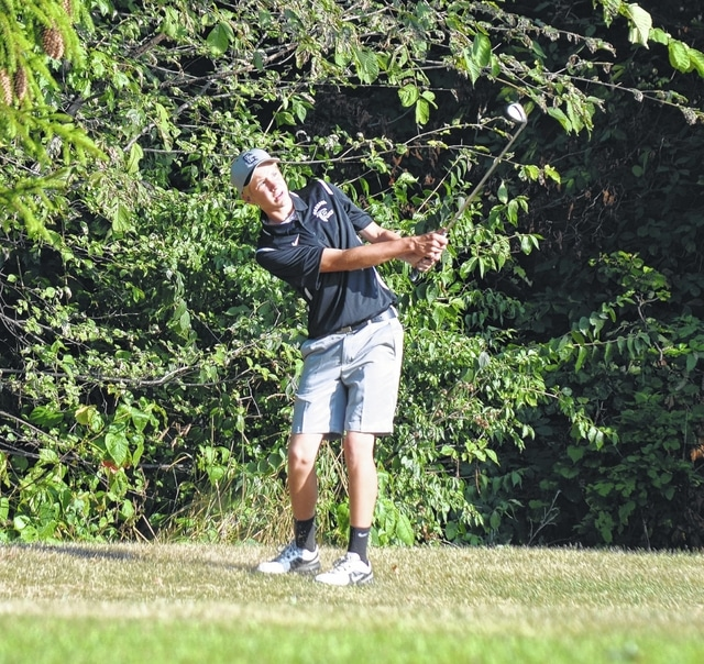 Graham's Andy Milligan pitches to the 12th green at Urbana Country Club on Tuesday morning.