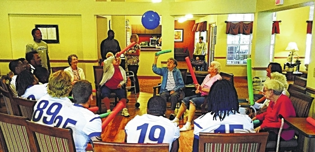 Members of the Blue Knight Football team enjoyed an afternoon with residents of the Brookdale Senior Community during Urbana University's first weekend of a new year.