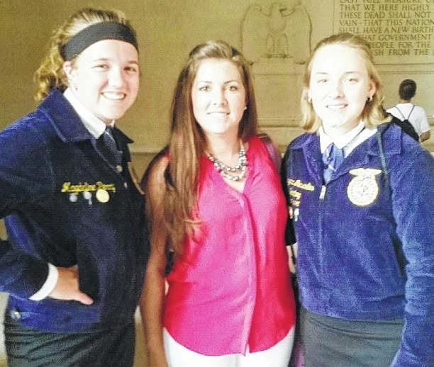 Pictured from left at the Lincoln Memorial in Washington, D.C. are Urbana Chapter Treasurer Magdaline Perry, Advisor Mallory Zachrich and Chapter President Cheyenne Gunsaulies.