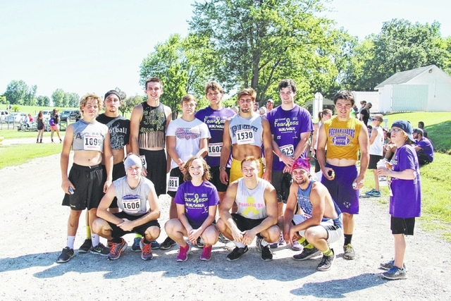 "The annual Fearless 5K to benefit juvenile cancer survivors will be held in Goshen Memorial Park, Mechanicsburg on Saturday. Pictured is the ""elite"" division from last year. Front row, left to right: Tyler Wetzel, Colton McMannis, Ellie Herdman, Jim Gano, Josh Brown, Hunter Hensley. Back row, left to right: Drew Vanvoorhis, David Harvey, Tanner Smith, Cannon Propst, Kaleb Romero, Luke Marsh, Jake Bowers."