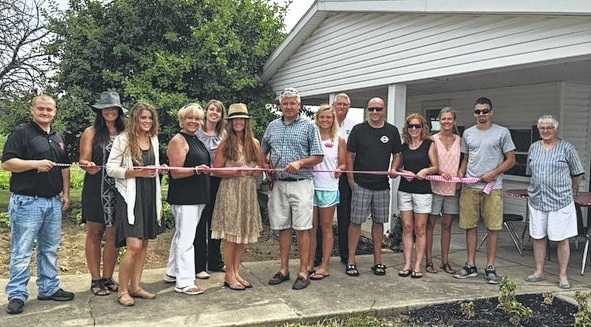The Champaign County Chamber celebrated new local business The Hippie & The Farmer with a ribbon-cutting on July 21 at Oakview Farm. From left are Isaac Garrison, Emily MacKendrick, Sarah Thornton, Chamber Executive Director Sandi Arnold, Jessica Stebbins, The Hippie & The Farmer co-owners Pam Bowshier and Mark Runyan, Emmy Runyan, Jerry Baumbauer, Ryan Hostetler, Heather Hostetler, Linda Runyan, Myer Runyan and Barb Boerger.
