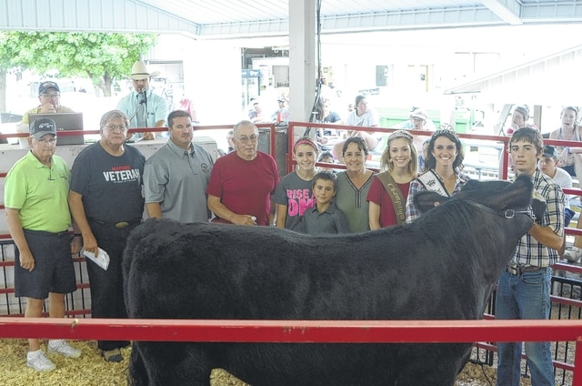 Lear Current's Champion 4-H Rate of Gain Steer sold for $600 to Champaign County Sheriff Matt Melvin, Maine's Towing and Collision, and Perpetual Federal & Savings Bank.