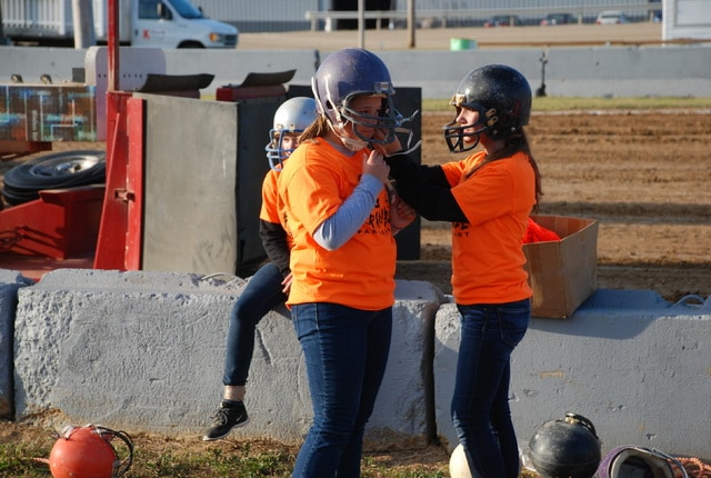 Girls ready their safety equipment for the pig scramble at the 2016 Champaign County Fair on Sunday night.