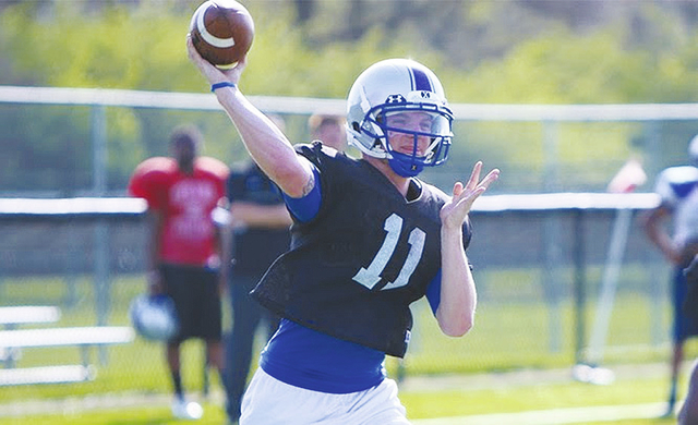 UU senior quarterback Cale Burdyshaw throws a pass during practice last spring.